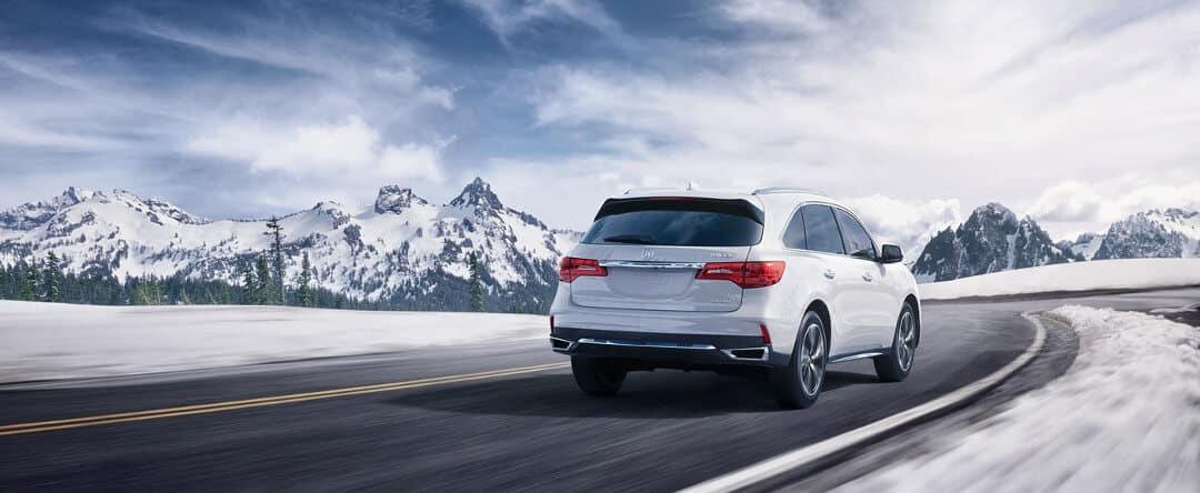 Acura MDX drives through snow