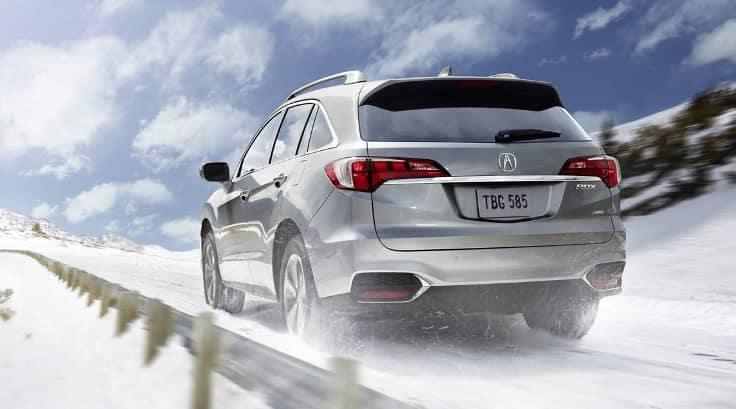 2018 Acura RDX drives through snowy terrain