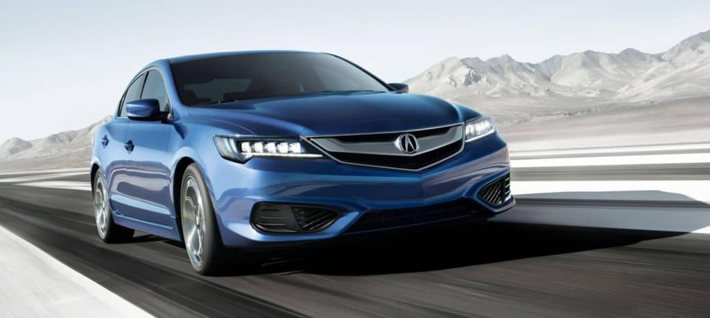Acura ILX driving by a mountain range