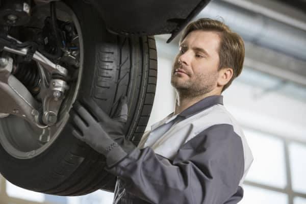 service tech changes tire