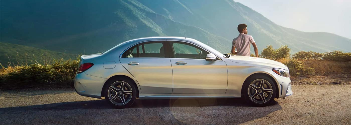 Man leaning on Mercedes-Benz C-Class