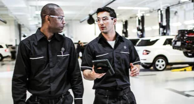 Technicians talking Mercedes-Benz