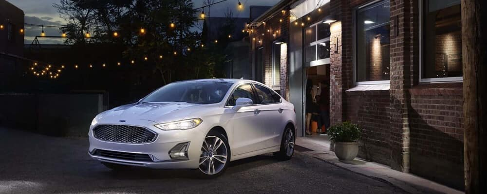 2020 Ford Fusion parked outside of garage at night