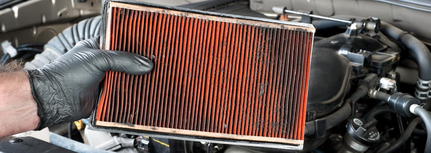 Dirty air filter being replaced