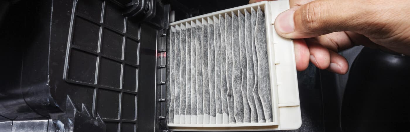 Dirty engine air filter being replaced