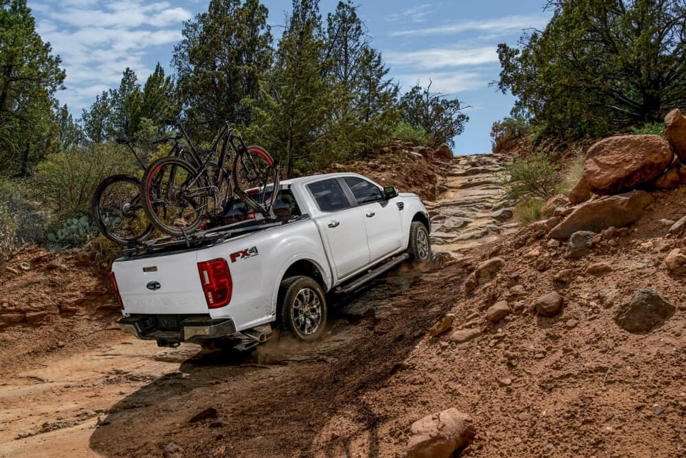 2021 Ford Ranger driving up a dirt hill