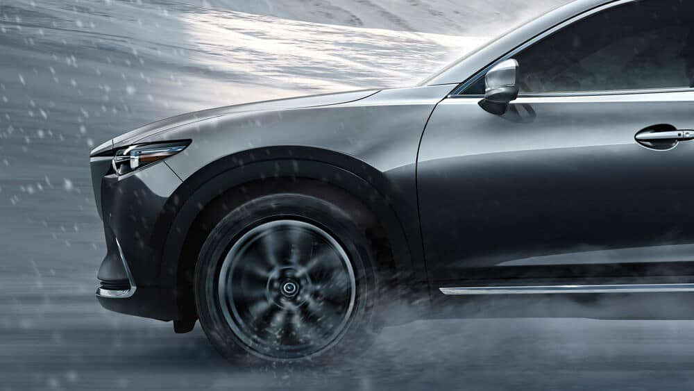 2018 Mazda CX-9 driving close up of front end and tire