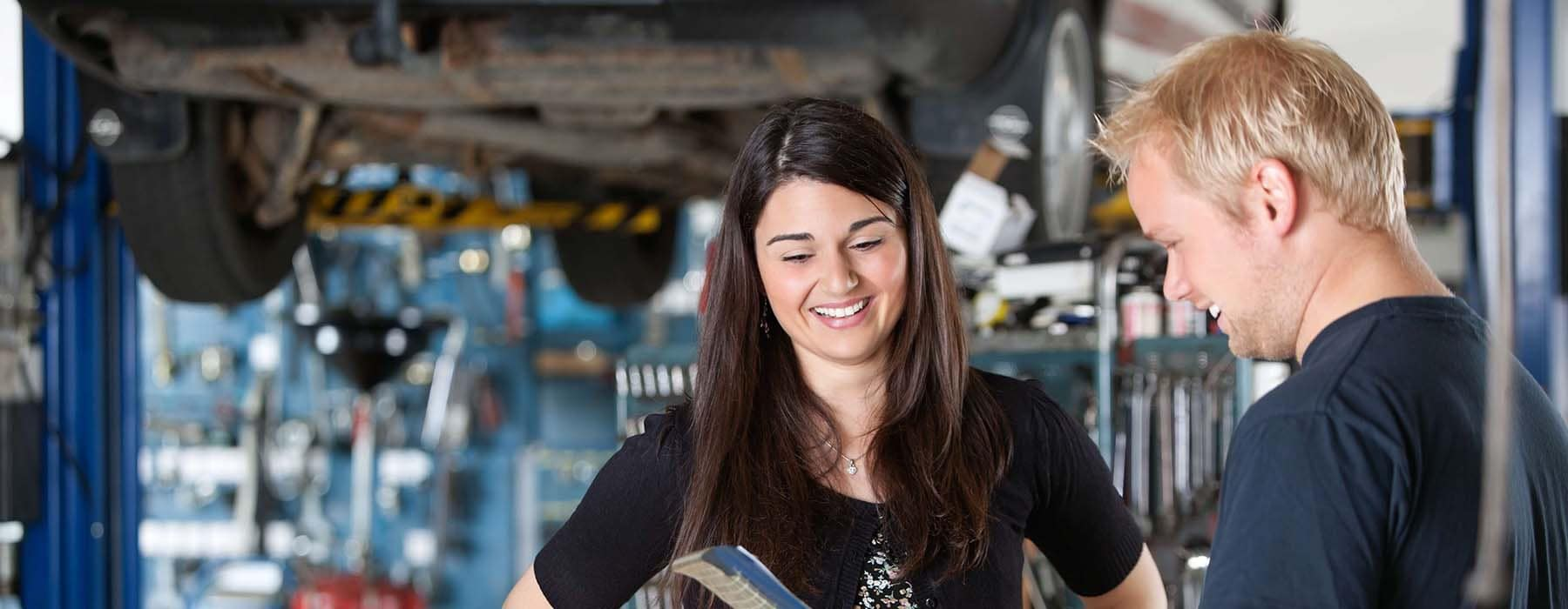 Mechanic Talking to Woman