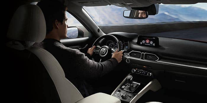Interior view of man driving a 2018 Mazda CX-5