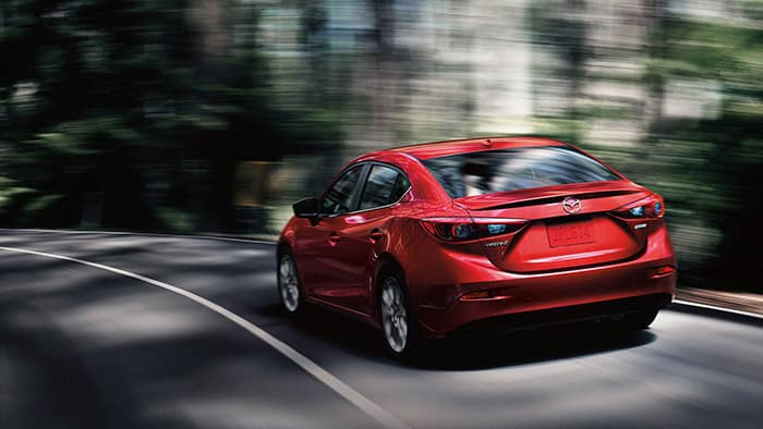 2018 Mazda3 Driving Wooded Street