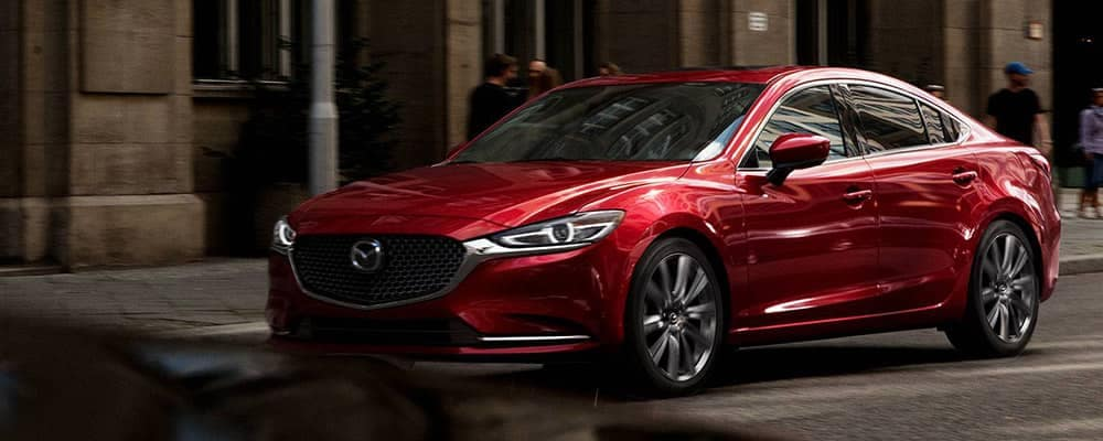 Red 2018 Mazda6 driving