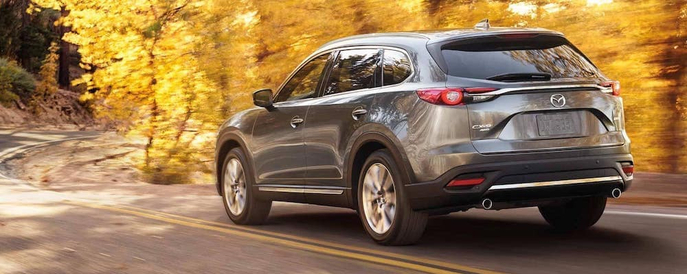 2018 Mazda CX-9 on road in the fall