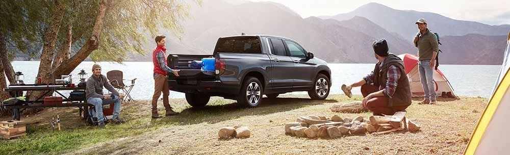 Honda Ridgeline parked at camping grounds