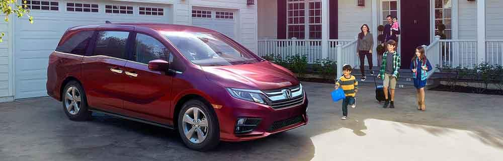 Honda Odyssey parked in front of home