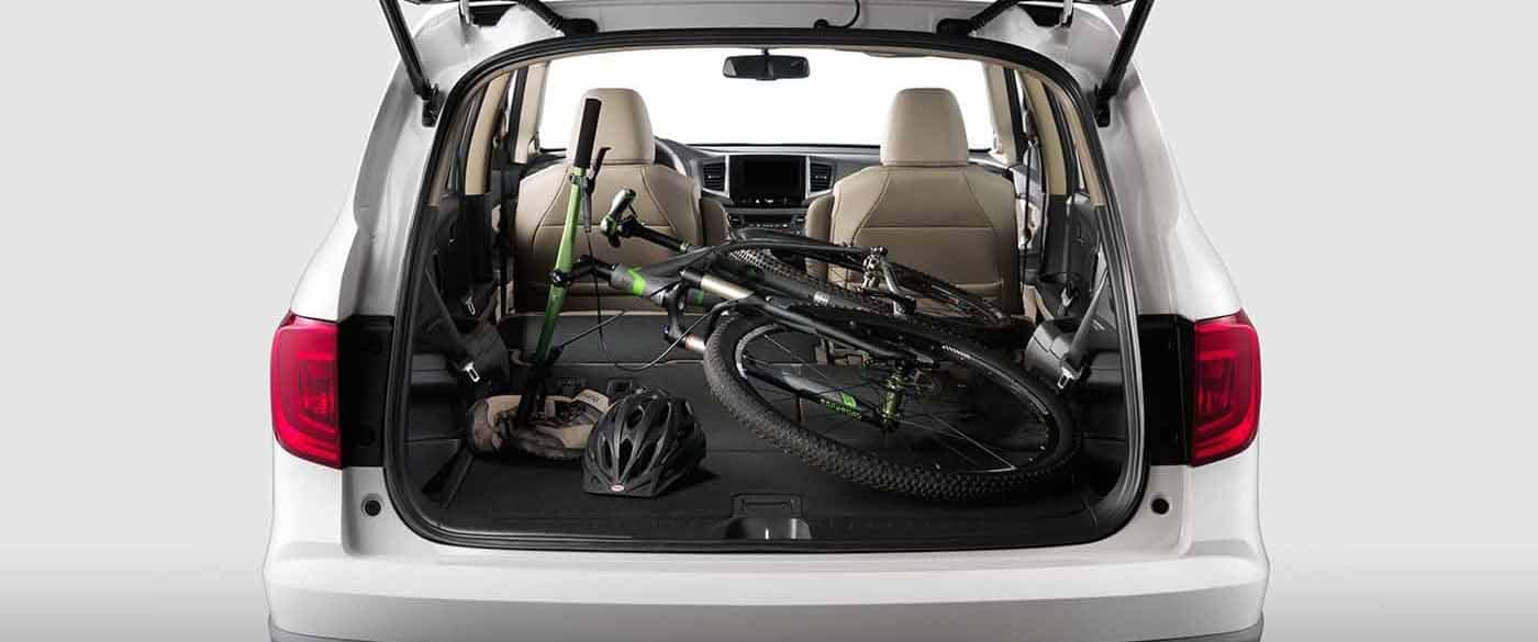 2018 Honda Pilot Cargo Area with seats down and full bike laid in back