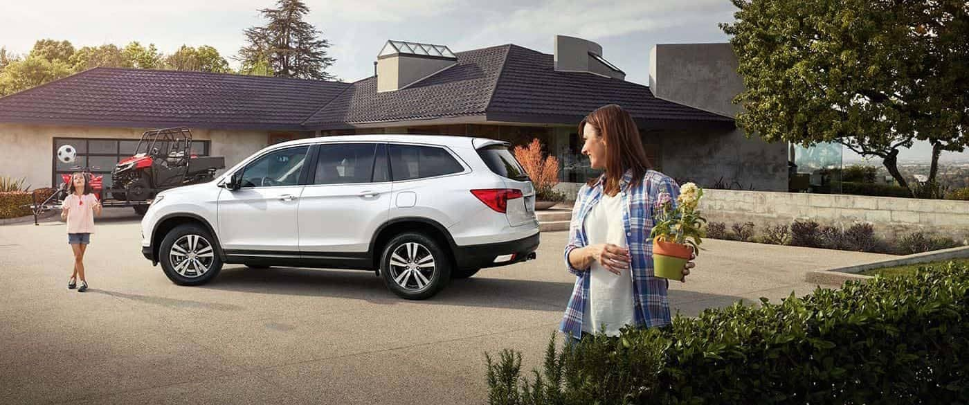 2018 Honda Pilot parked out front of home with trailer ready for hook up