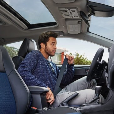 Driver behind wheel of 2018 Toyota Corolla