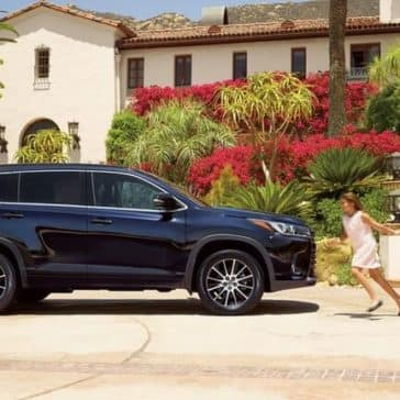 2018 Toyota Highlander in front of villa
