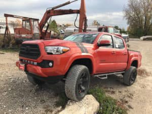 Red Toyota Tacoma off road image