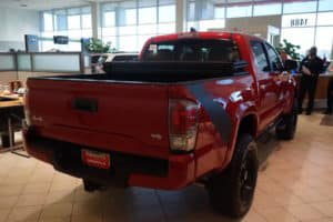 Red Toyota truck 4x4 V6 dealership