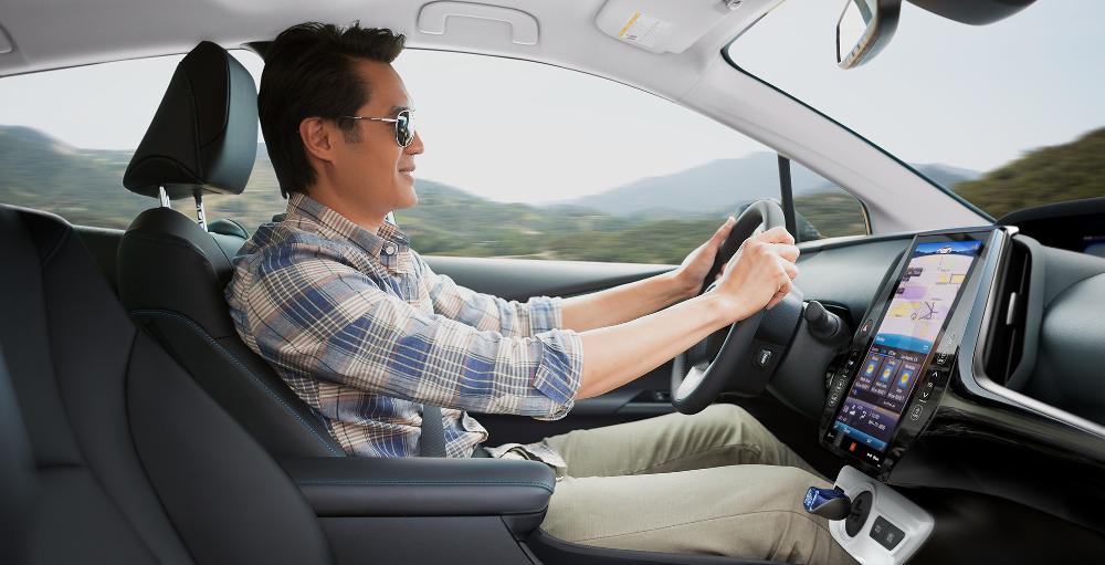 man driving 2018 Toyota Prius