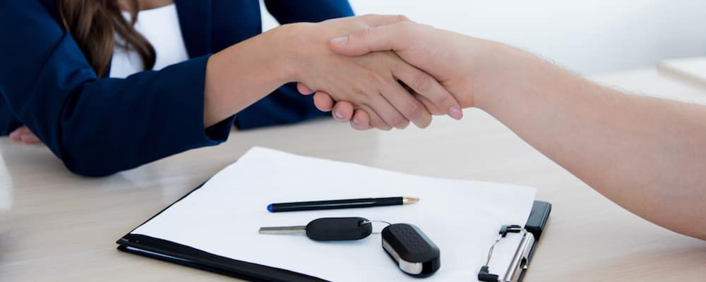 Handshake over lease paperwork