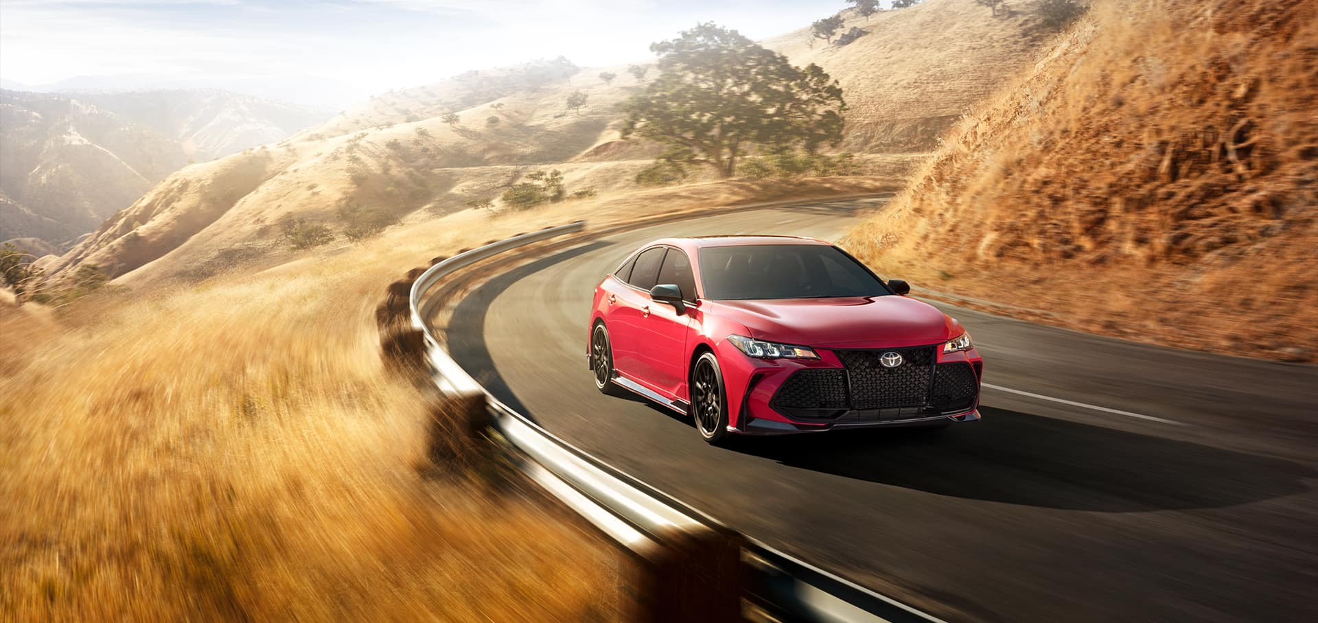 2020 Toyota red vehicle driving