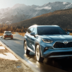 Two 2020 Toyota Highlander SUVs driving with mountains in background