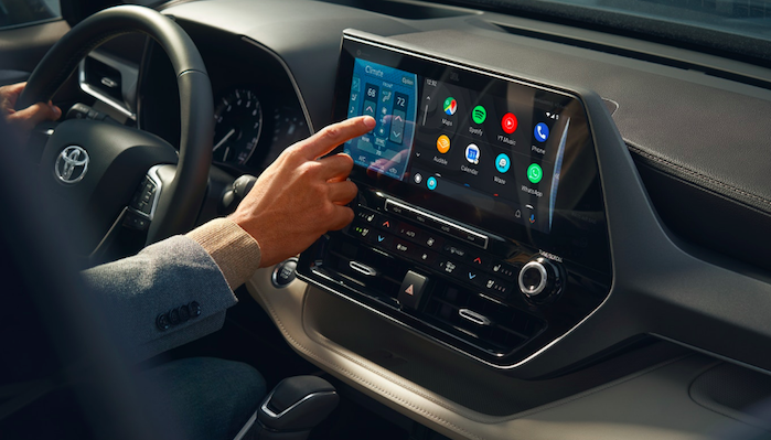 Someone using 2020 Highlander infotainment touchscreen