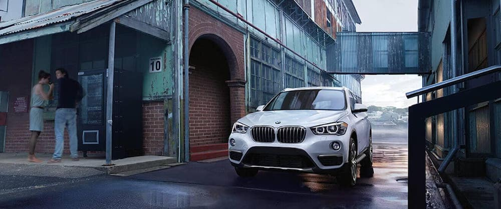 white 2018 BMW X1 parked in an alley