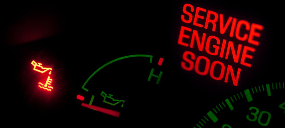 Service Engine Soon light in red on a car dash