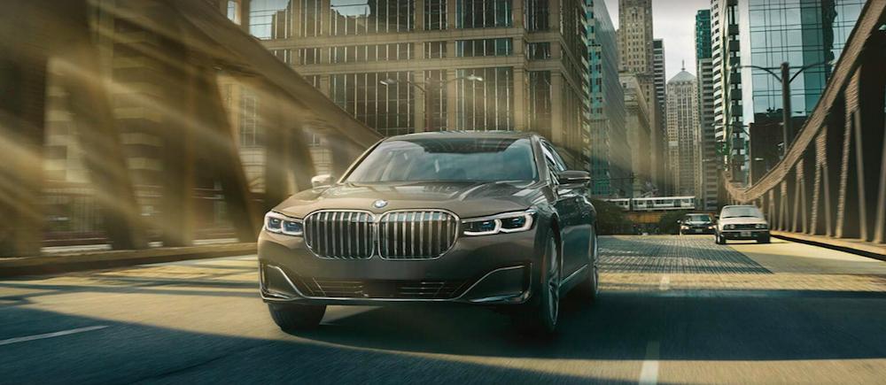 2020 BMW 7 Series Driving on a city bridge