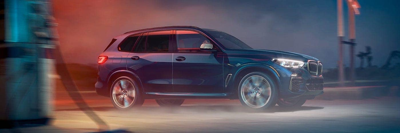 A 2020 BMW X5 driving at night