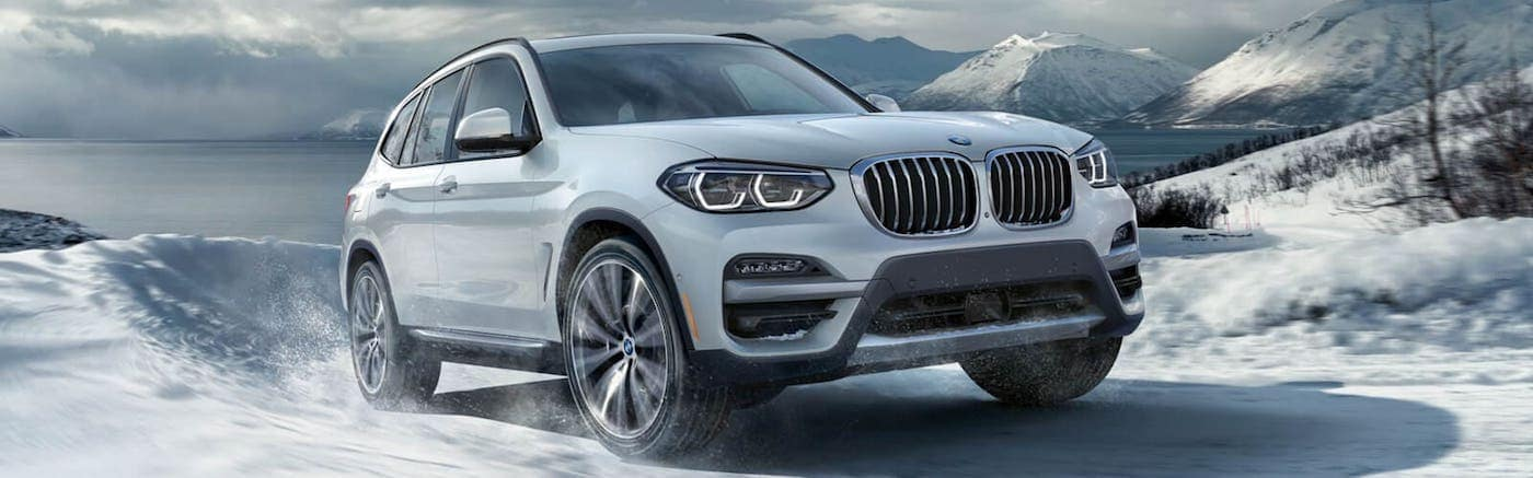 A 2020 BMW X3 Driving up a Snowy Hill