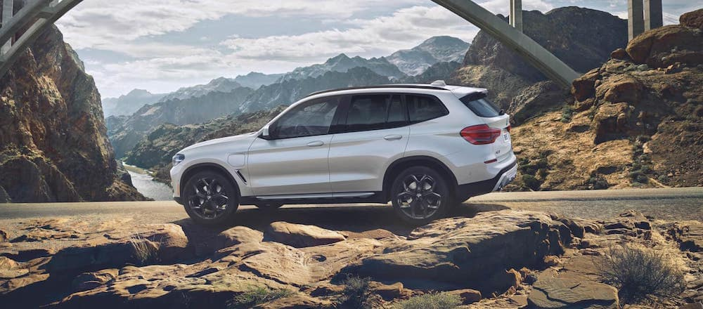 A 2020 BMW X3 driving on a mountain