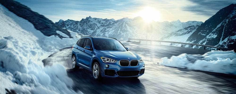 2019-BMW-X1-xDrive28i-accelerates-around-an-icy-corner