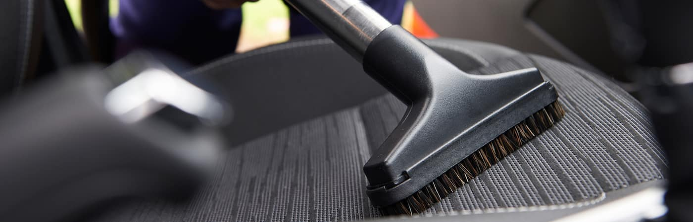 vacuum cleaning up car seats