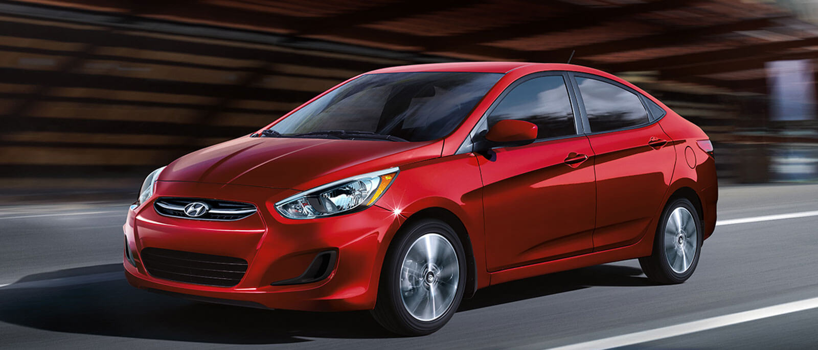 2017 Hyundai Accent in red driving through the city