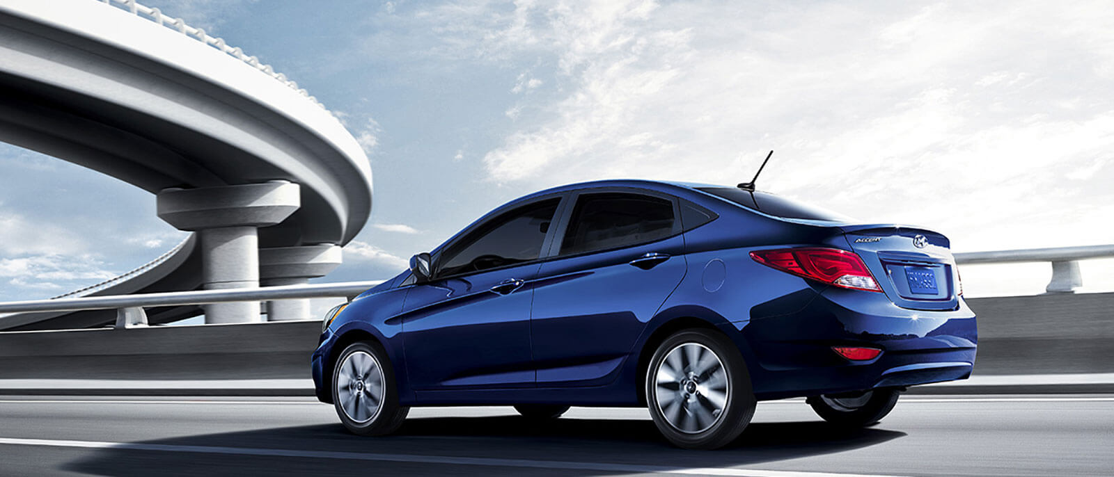2017 Hyundai Accent in blue driving down the highway