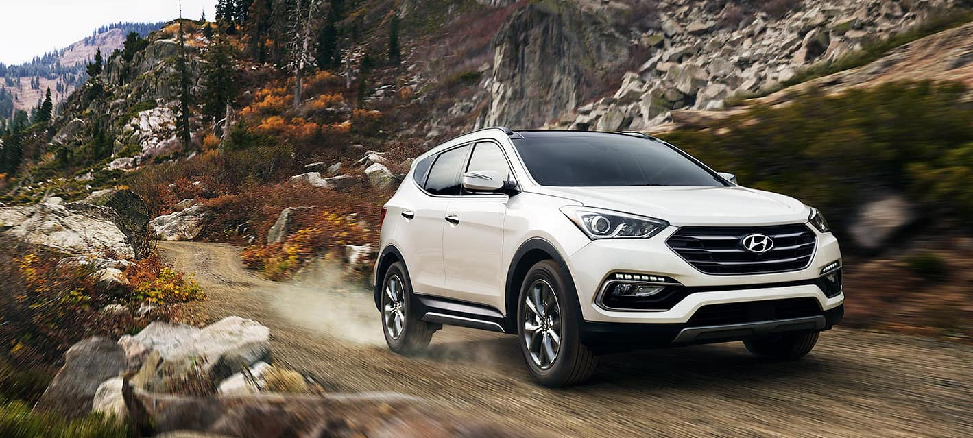 2018 Hyundai Santa Fe Sport in Frost White Pearl on a mountain road