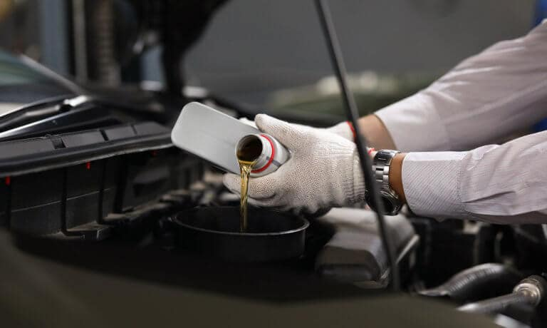 Service technician performing a brake replacement