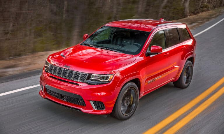 2020 Jeep Grand Cherokee exterior driving on forest highway