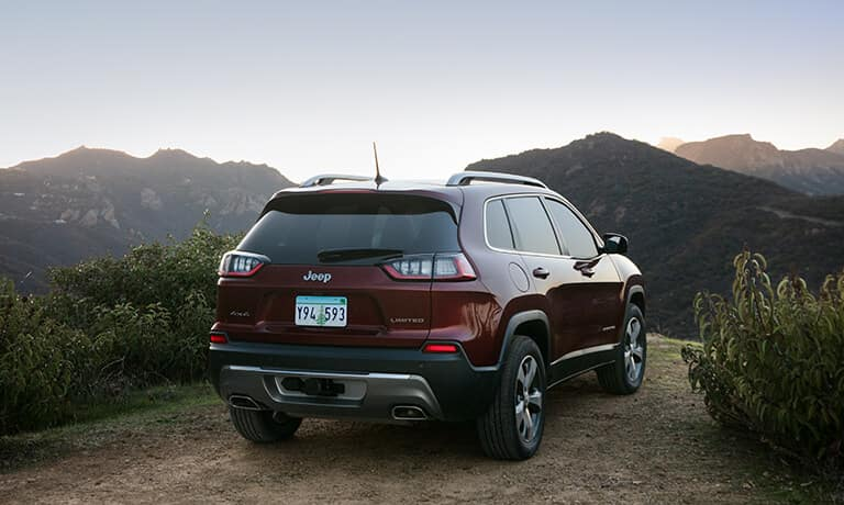 2021 Jeep Cherokee Exterior parked on a cliff against mountains