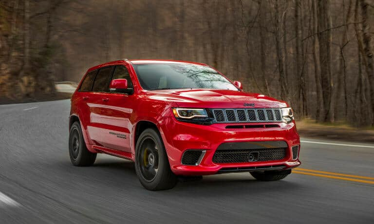 2021 Jeep Grand Cherokee exterior driving in forest