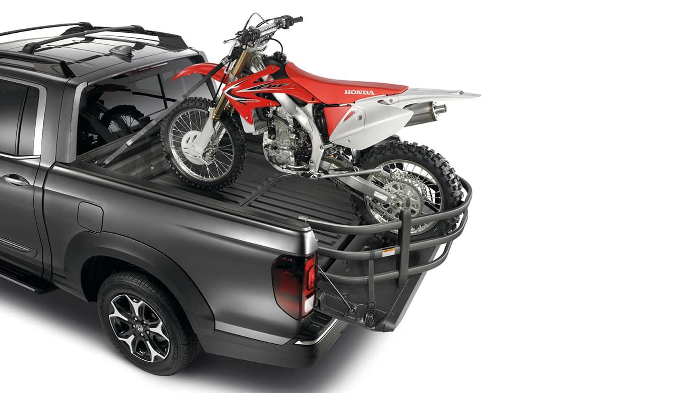 2018 honda ridgeline dirtbike parked