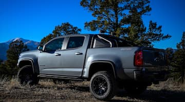 An exterior shot of a blue Chevrolet Colorado