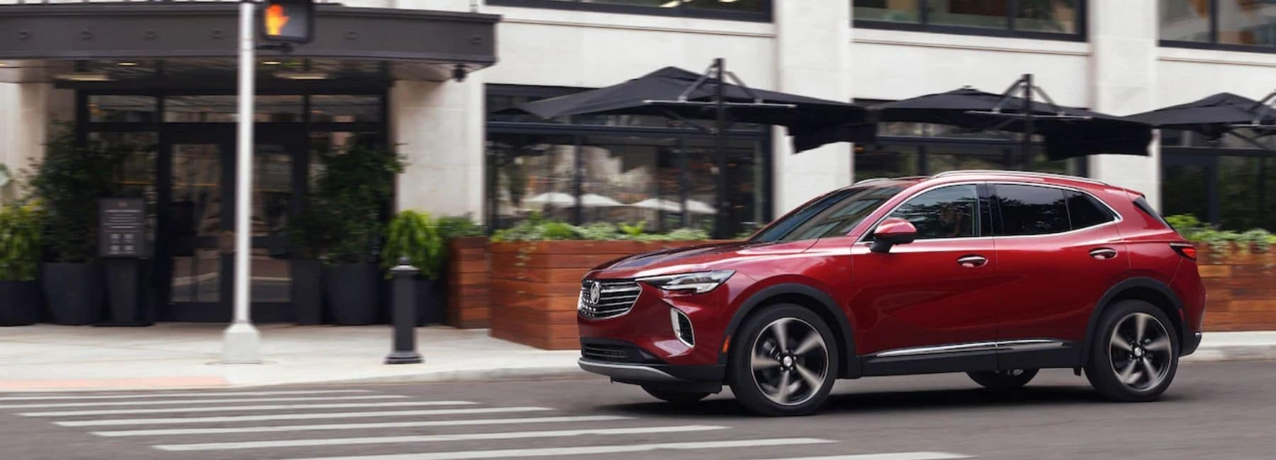 Red 2021 Buick Envision Driving Downtown