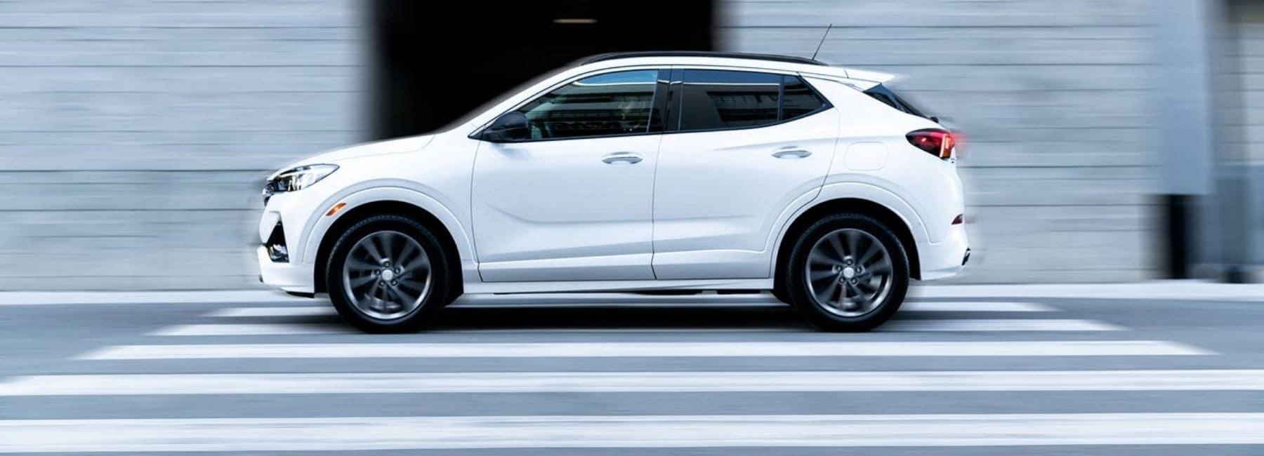 White 2021 Buick Encore GX Driving
