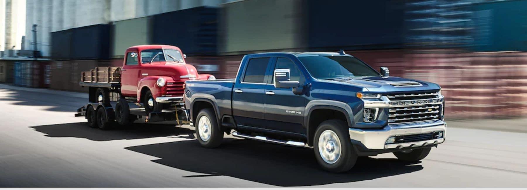 Blue 2021 Chevrolet Silverado 2500 Towing An Old Red Chevy Truck   Chevrolet Dealer Near Mescalero, NM