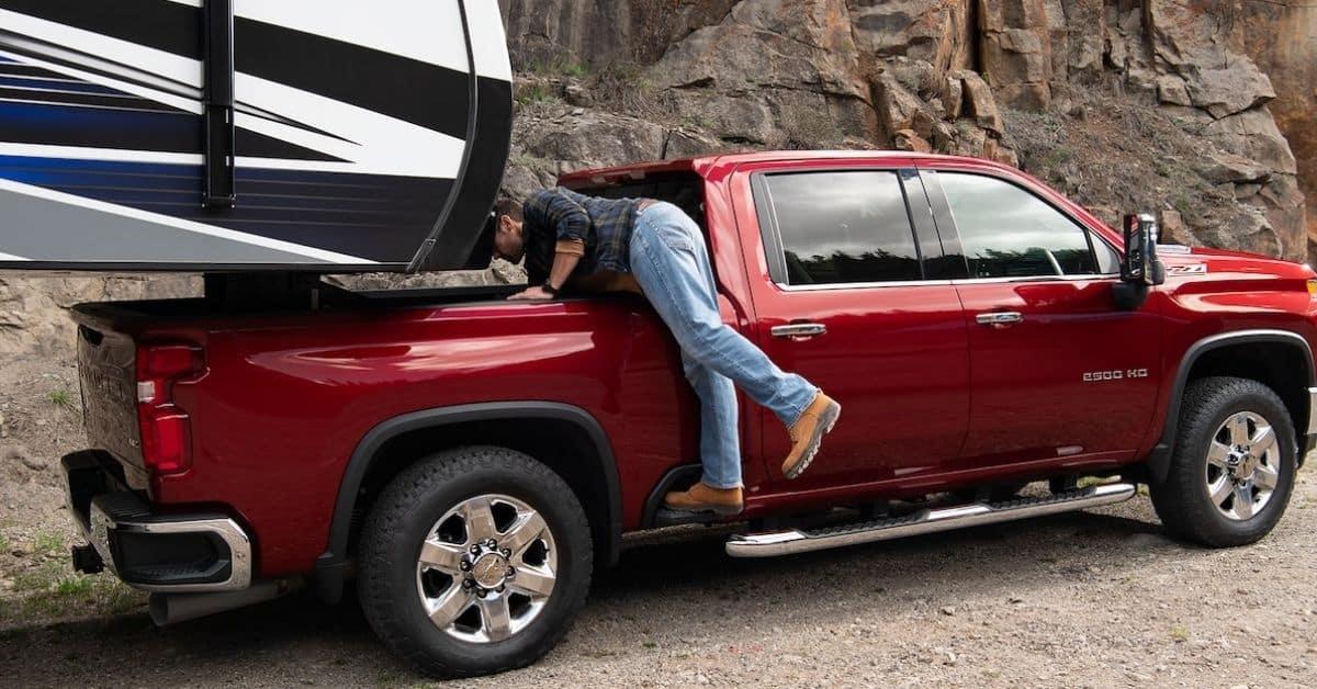 Red 2022 Chevrolet Silverado HD Towing A Camper
